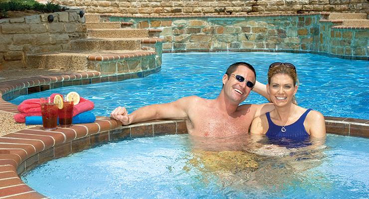 Happy couple enjoying the hot tub