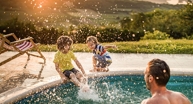 Kids playing in heated pool water
