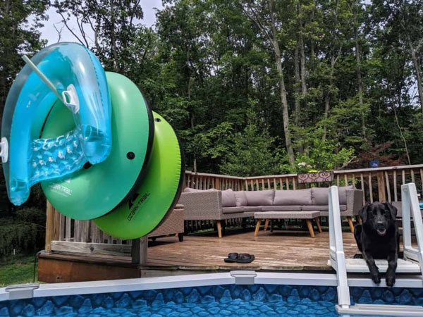 Hanging pool floats on PVC storage rack