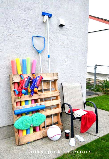 Wooden pallet used for storing pool accessories