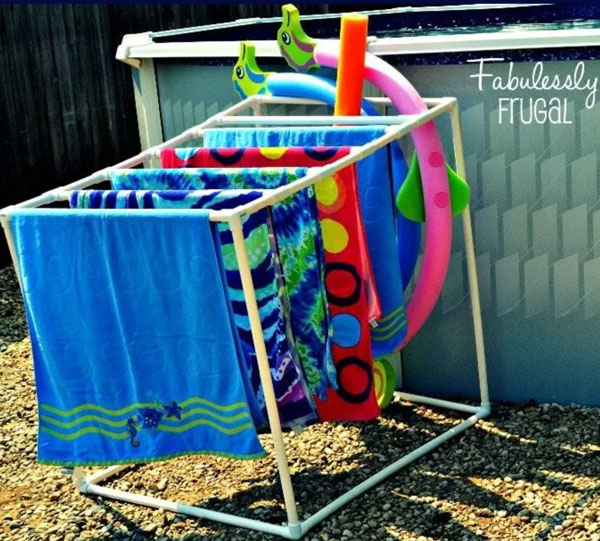 Towels and pool noodles on storage rack