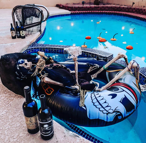 Drunk Halloween Skeleton in Pool