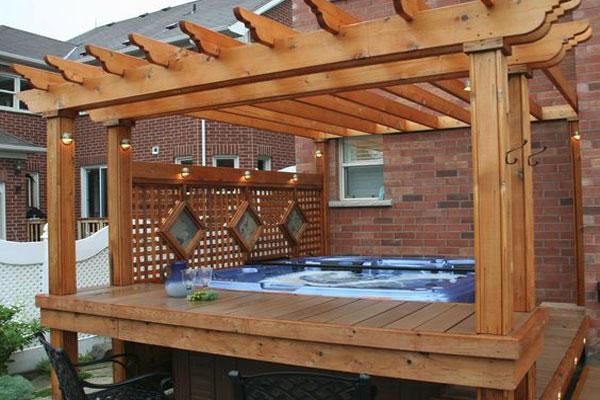 Jacuzzi spa with wood pergola and lattice