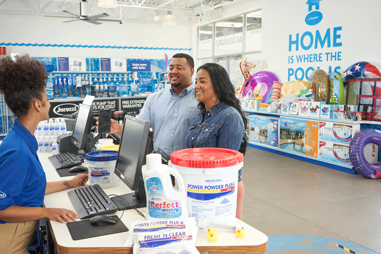 Leslie's associate with customers at the register