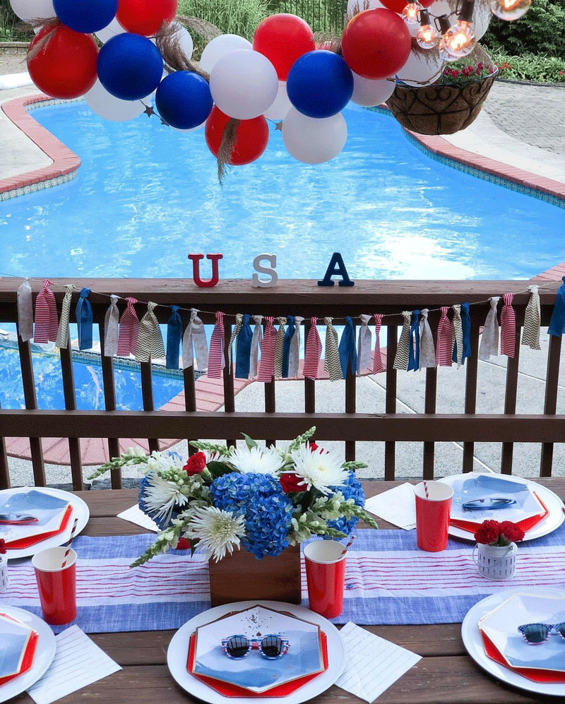 USA-themed decorations on table in front of pool