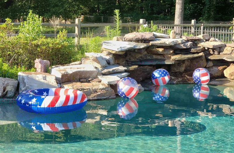 Red White and Blue tube and balls in pool